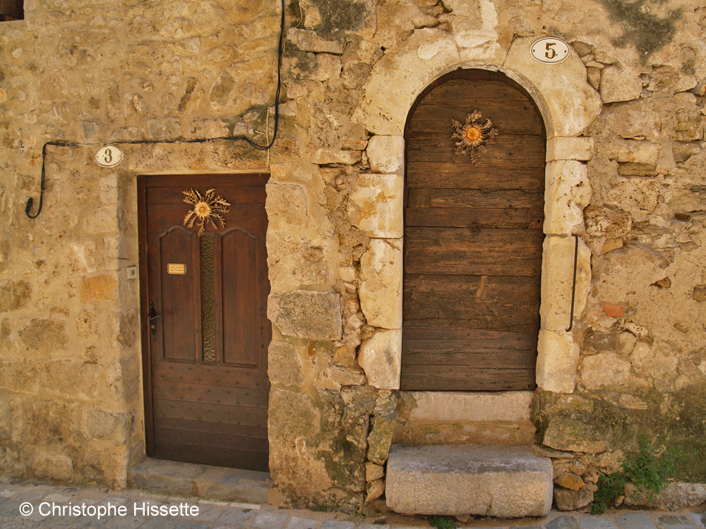 Cardabelles on the doors, Saint-Guilhem-le-Désert, France