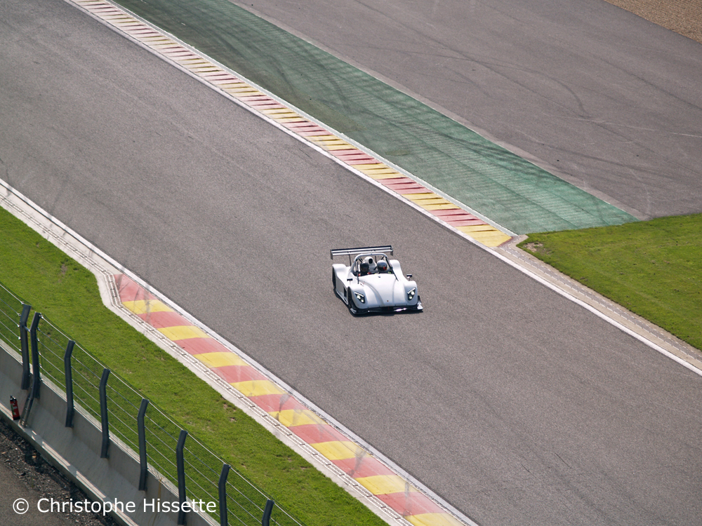 Radical SR3 RSX at the straight line of descent before the double gauche du Pouhon corner